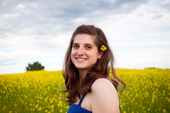 beautiful girl in canola field
